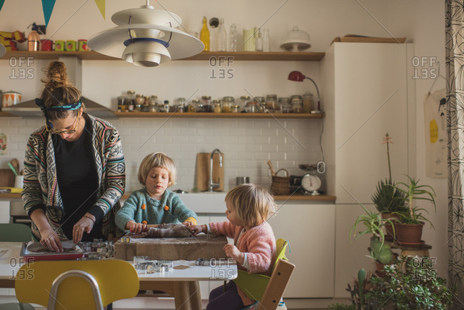 Woman and her daughters baking cookies
