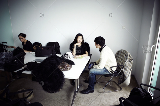 Beijing, China - February 8, 2012: Couple sitting at a table having a conversation in Beijing, China