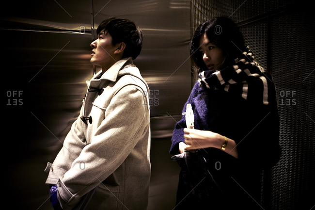 Beijing, China - February 8, 2012: Couple riding in an elevator in Beijing, China