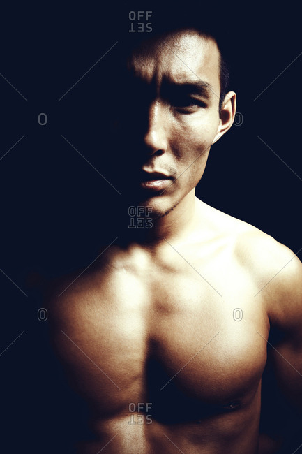Beijing, China - May 16, 2012: Close up of athletic shirtless man
