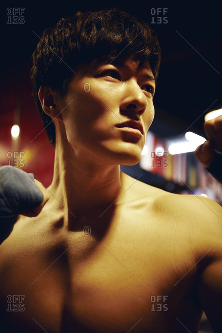 Beijing, China - February 11, 2012: Boxer standing with fists up in a gym