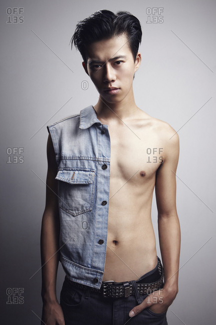 Beijing, China - August 6, 2012: Asian male model wearing a jean vest and metal belt