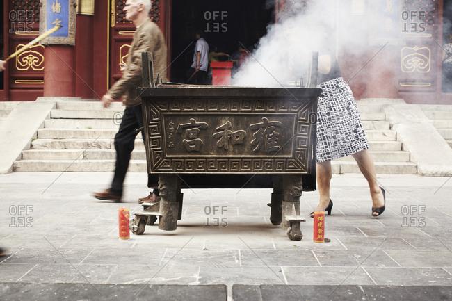 Beijing, China - September 16, 2013: Smoke from burning incense at the Yonghegong Temple, Beijing, China