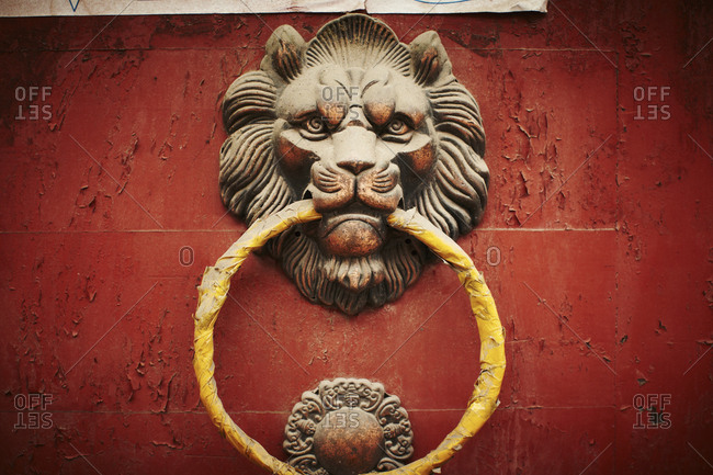 Red door with a lion door knocker in Beijing, China
