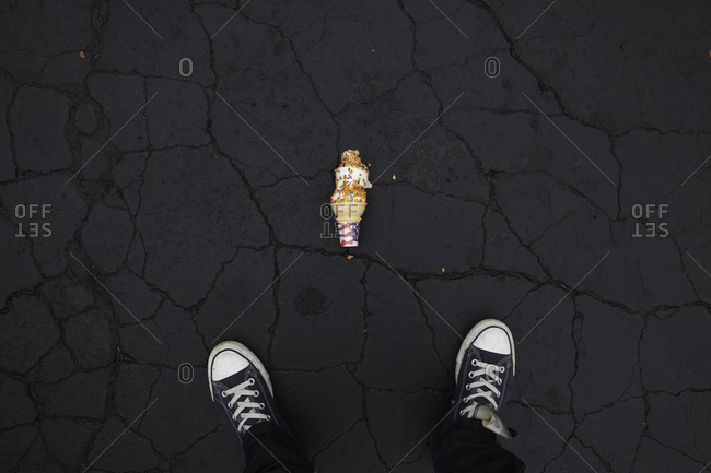 Ice cream cone dropped on asphalt