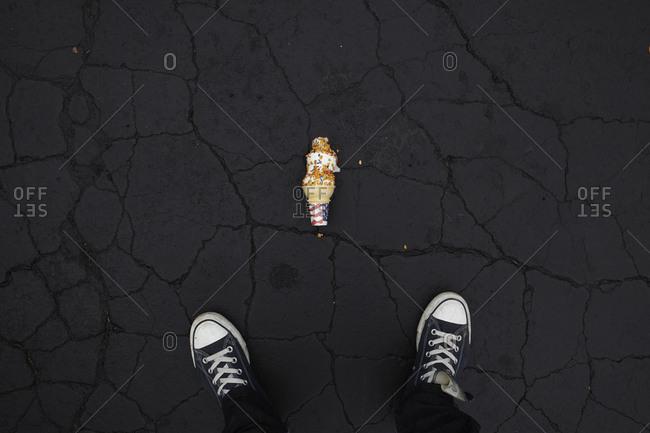 Ice cream cone dropped on asphalt