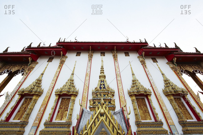 Low angle view of the Chaithararam Temple - Wat Chalong in Phuket, Thailand