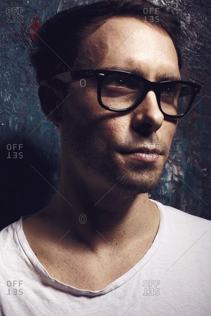 Beijing, China - May 4, 2014: Man wearing trendy glasses in Beijing, China