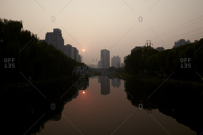 Beijing, China - October 7, 2014: Sunset over river in Beijing, China