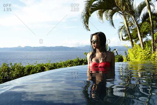 Savusavu, Fiji - February 17, 2015: Woman in bikini relaxing in a pool, Savusavu Bay, Savusavu, Fiji