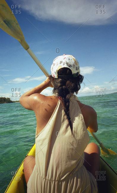 Woman kayaking in the ocean near Yasawa Island, Fiji