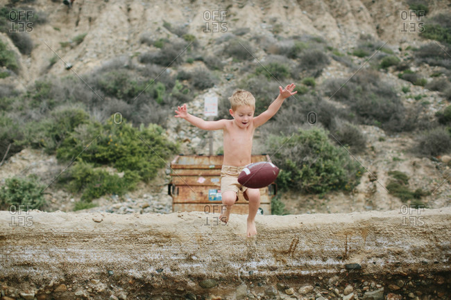 Boy jumping for a football