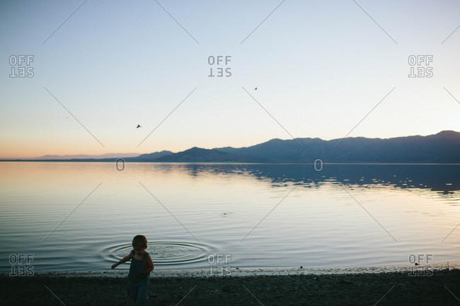 Boy by a lake at dusk