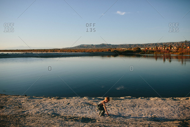 Boy at edge of a lake