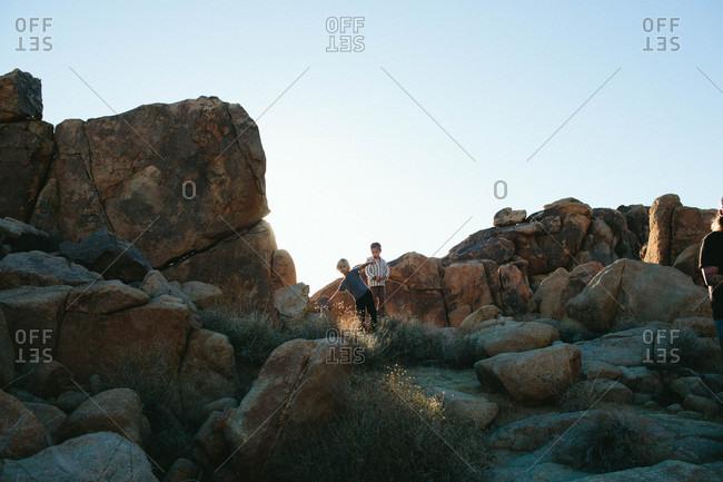 Boys exploring among boulders