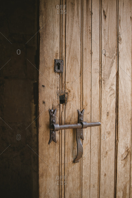 Rustic wooden door with latch and keyhole