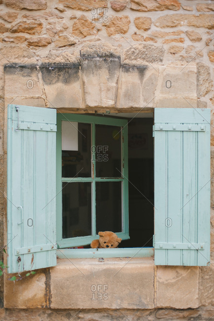 House with blue shutters and a teddy bear in Sarlat-la-Can_da, France