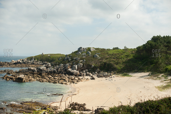 Rocky shore and beach on the coast of Galicia, Spain