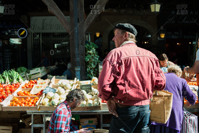 Mirepoix, France - July 22, 2015: Shoppers at a farmer's market