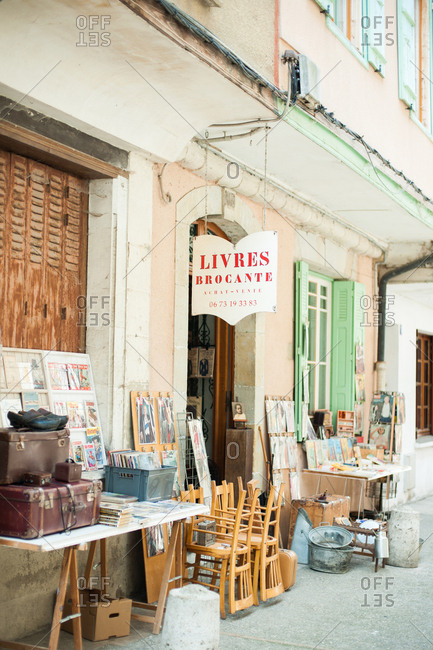 Mirepoix, France - July 22, 2015: Exterior of a bookstore with goods for sale on the sidewalk