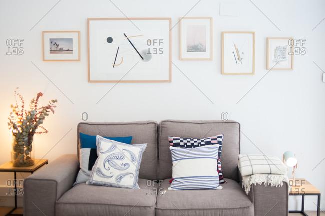 Donostia / San Sebastian, Spain - July 22, 2015: Gray sofa in a furniture store in Spain