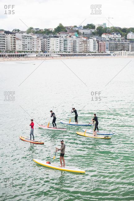 Donostia / San Sebastian, Spain - July 22, 2015: Paddle boarders off the coast of the Beach of La Concha