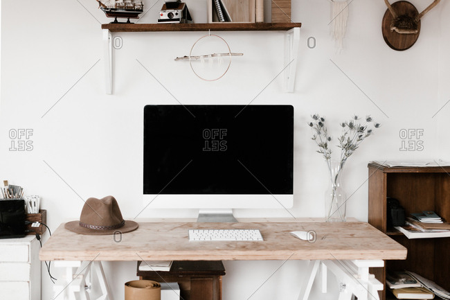 Stylish desk in a home office with a desktop computer