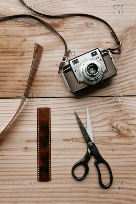 Vintage camera, scissors and film on a table
