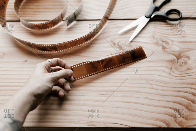Hand holding a strip of film