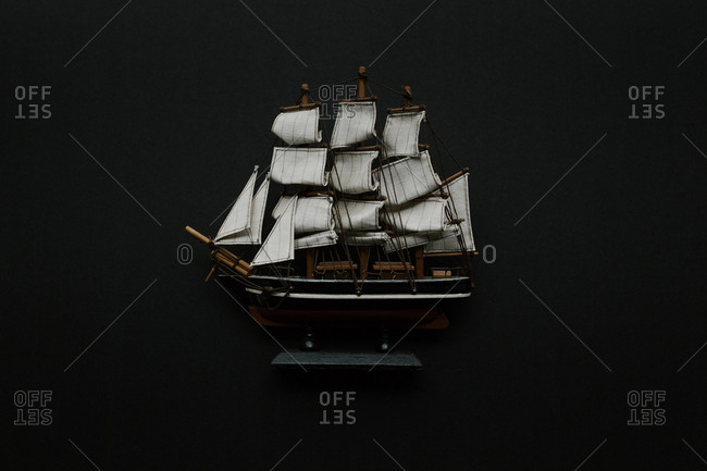 Old-fashioned model ship with sails