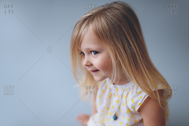 Portrait of a cute blond-haired toddler girl