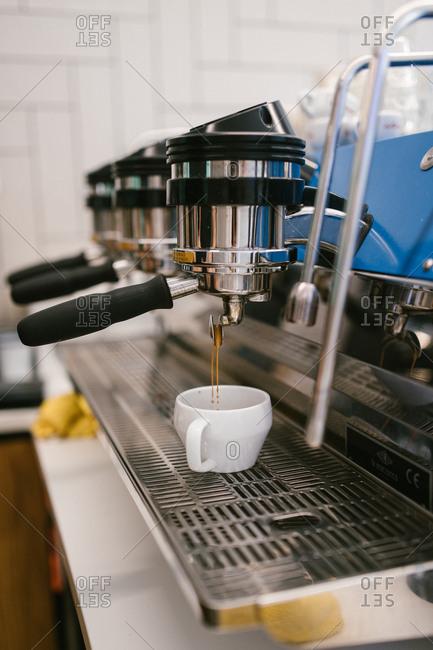 Espresso machine brewing cup of espresso