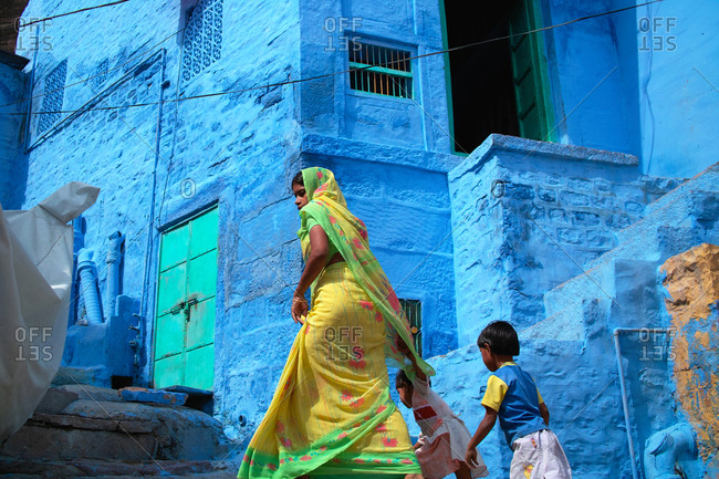 Jodhpur, India - October 19, 2009: Mom and two children in Blue City
