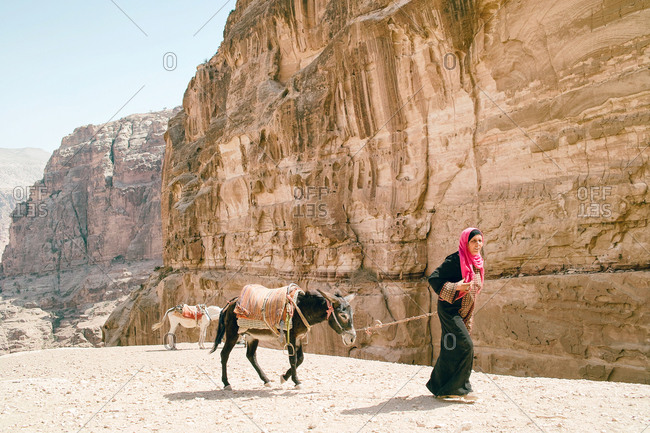 Petra, Jordan - May 19, 2010: Bedouin woman with donkey