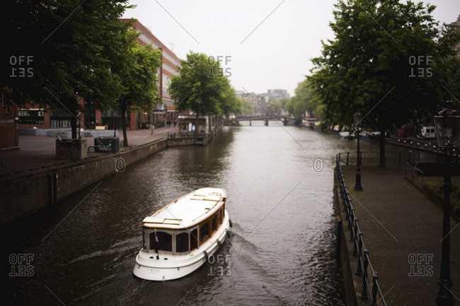 Boat on a canal through Amsterdam