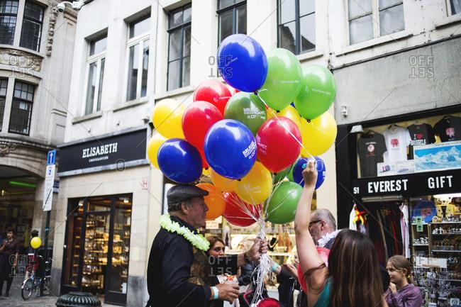 Brussels, Belgium - July 10, 2014: Man selling balloons in street