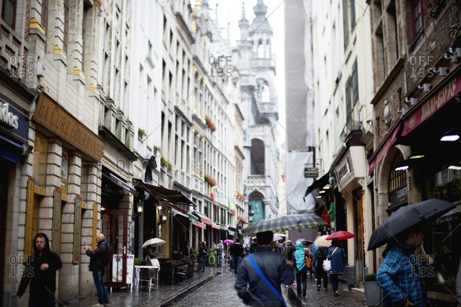 Brussels, Belgium - July 11, 2014: People in rainy street