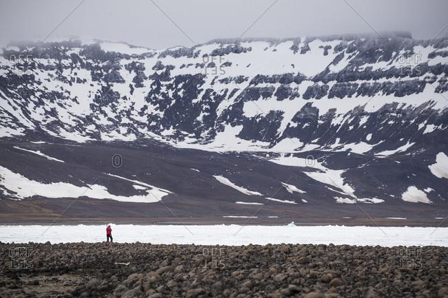 Hunter walking through arctic landscape in Franz Josef Land
