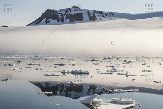 Snowy mountain reflection on the coast of Franz Josef Land