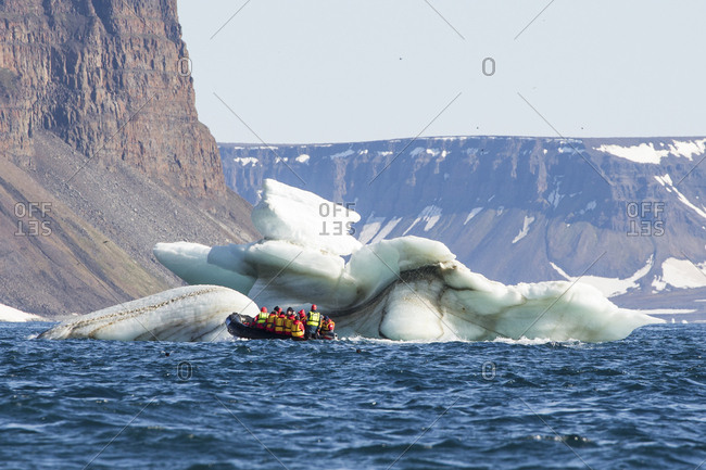 Boat tour by glacier off the coast of Franz Josef Land
