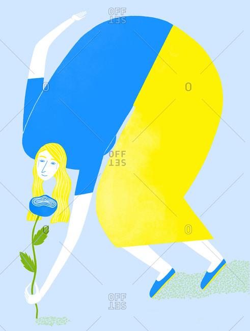 Blonde woman picking a blue flower