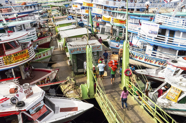 Manaus, Brazil - February 26, 2015: Tour boats and water taxis all parked at the Manaus Fish Market on the Amazon