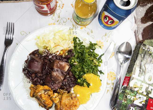 Amazonas, Brazil - February 27, 2015: Feijoada with rice, collard greens cut oranges and a side of marinated chicken
