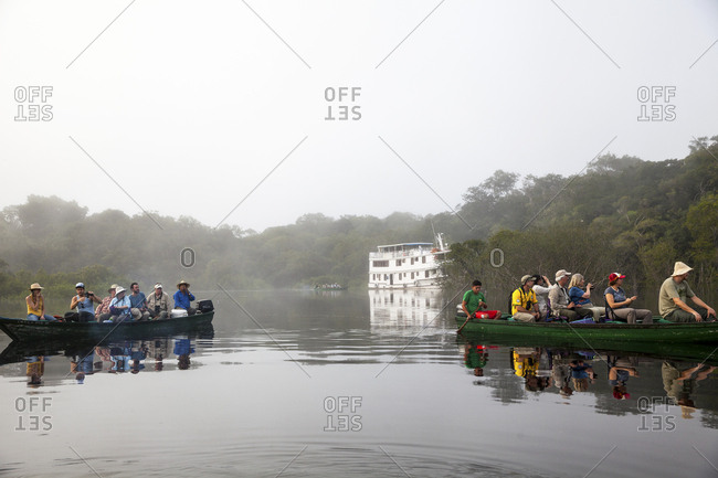 Tourists on Amazon river at dawn