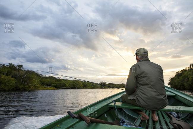 Fisherman at dawn on the Amazon