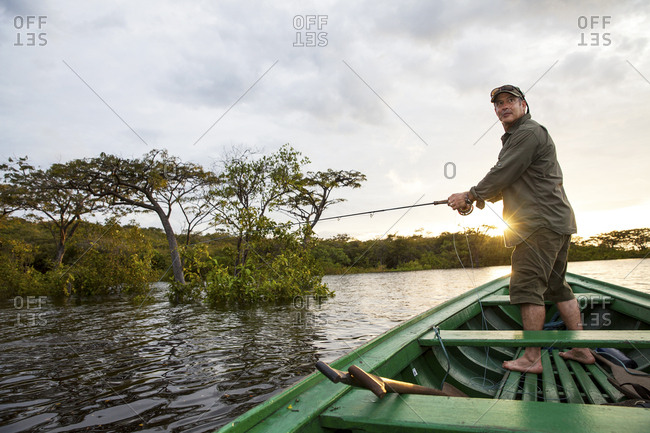 Fisherman at dawn on the Amazon river
