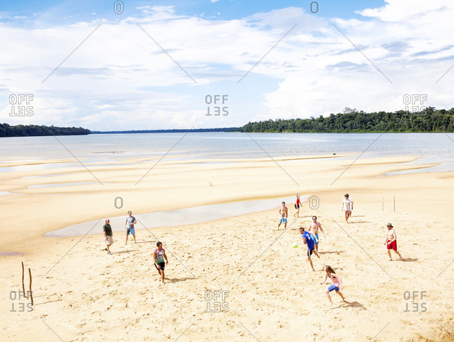 Tourists playing soccer on Amazon sandbar