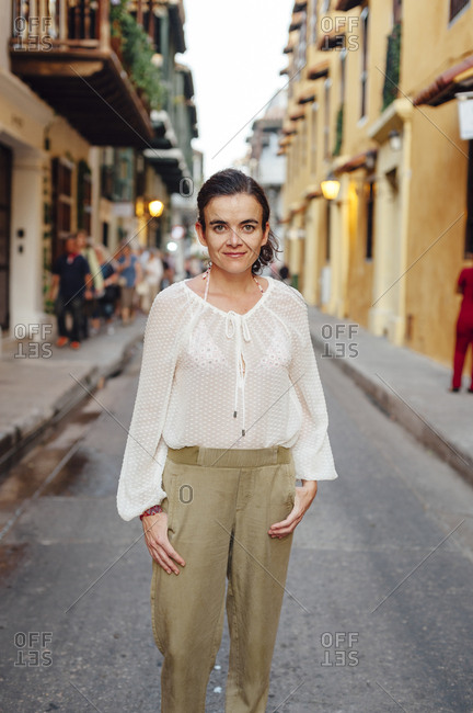 Woman looking at the camera in the main street of the old town of Cartagena de Indias, Colombia