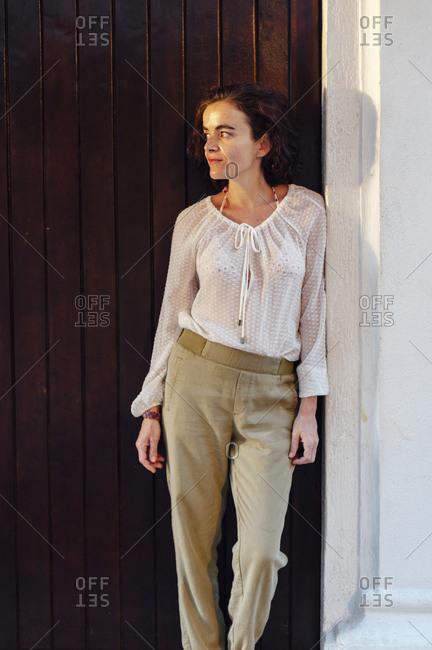Woman posing in a wooden door in the old town of Cartagena de Indias, Colombia