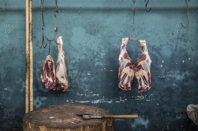 Pieces of meat hanging in Gyumri's market butchery